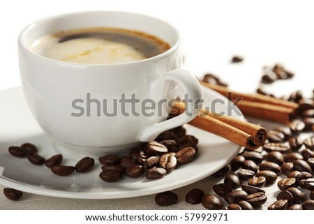 cup of coffee and roasted beans isolated