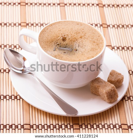 Cup of coffee and sugar close up top view. Coffee concept. Selective focus. - stock photo