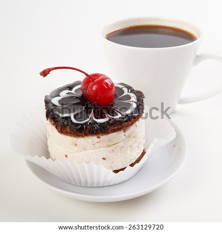 cup of coffee and sweet cake