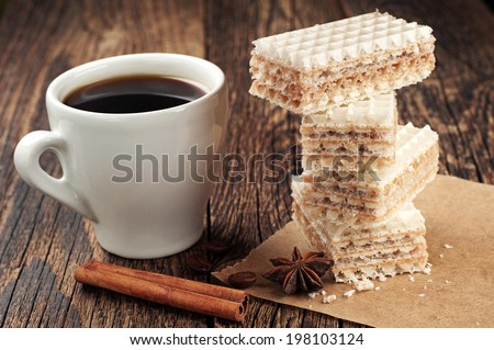 Cup of coffee and sweet waffles with condensed milk - stock photo