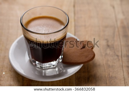 Cup of coffee and two heart shaped cookie, selective focus - stock photo