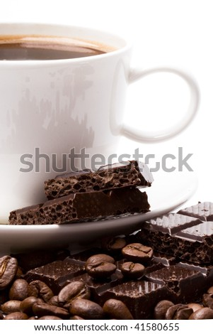 cup of coffee, beans and black chocolate closeup - stock photo