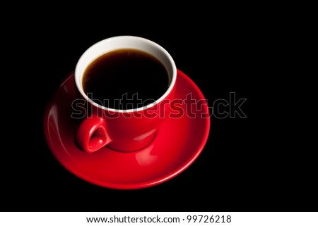 cup of coffee black background red mug