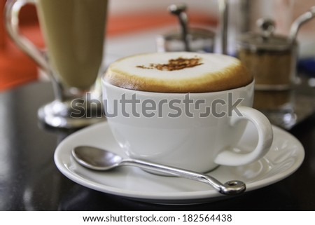 Cup of Coffee Cappuccino or latte  in a mug - stock photo
