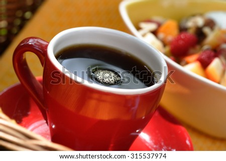 Cup of coffee, cereals in the background - stock photo