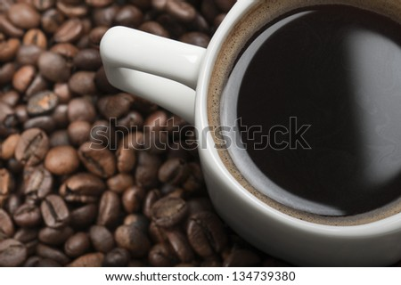cup of coffee closeup on coffee beans - stock photo