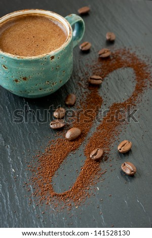 Cup of coffee, coffee beans and ground coffee - stock photo