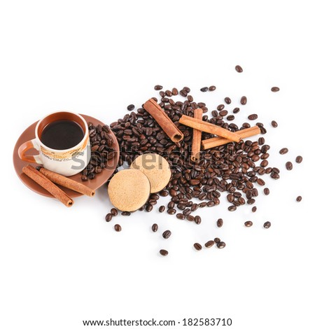 Cup of coffee, coffee beans, biscuits and cinnamon sticks on white background