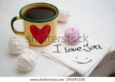 Cup Of Coffee. Coffee in cup with red heart and dessert. Handwriting I love you. Creative concept. - stock photo