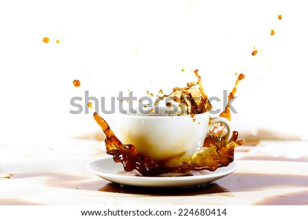 Cup of coffee creating splash. White background, coffee stains. Coffee break, breakfast concept. - stock photo