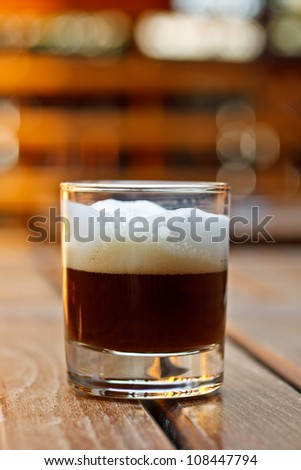 Cup of coffee espresso served on bar table