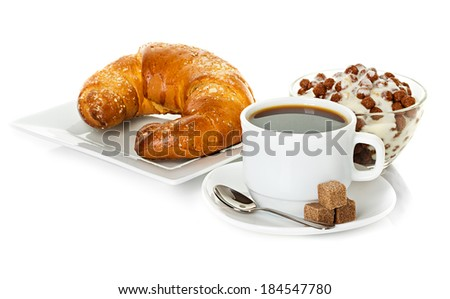 cup of coffee, fresh croissants and muesli