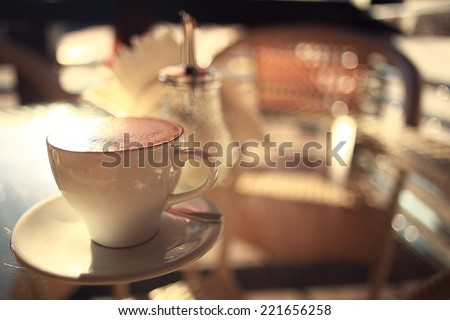 cup of coffee in a cafe on the table - stock photo