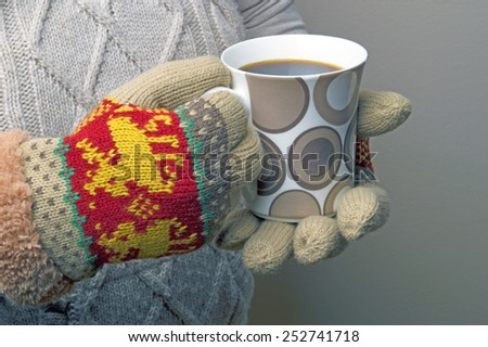 cup of coffee in hand - stock photo