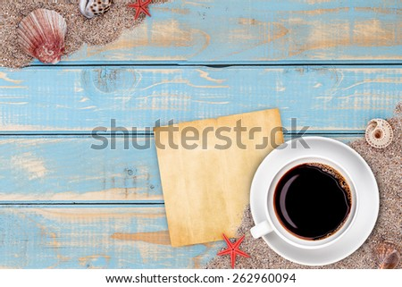 Cup of coffee in summer holiday ambience - stock photo