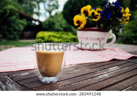 cup of coffee in the garden - stock photo