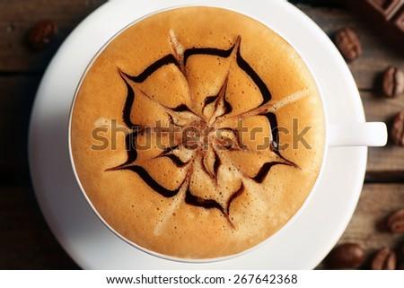 Cup of coffee latte art, closeup - stock photo