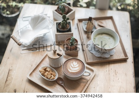 Cup of coffee latte art in coffee shop on thailand Japaness&hipster Style - stock photo