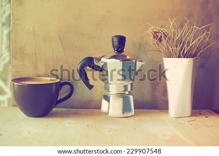 cup of coffee latte art on the wood desk vintage color tone - stock photo