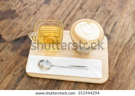Cup of coffee latte art on wood table - stock photo