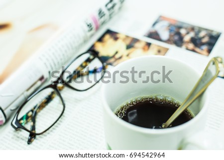 Cup of coffee, Magazine and Glasses Background