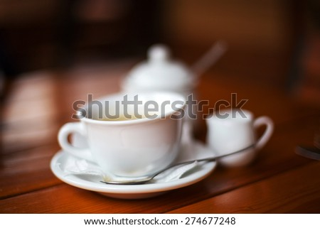 Cup of coffee. Morning atmospheric lighting, fashionable trendy spot soft focus. Preparation for design creative menu.