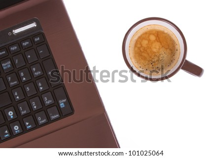 Cup of coffee near laptop, business concept