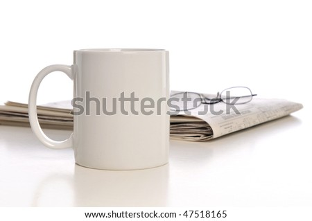 Cup of coffee, newspaper and glasses isolated on a white background - stock photo