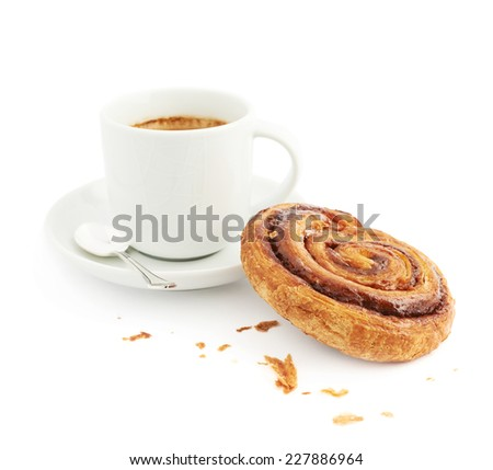 Cup of coffee next to cinnamon bun composition, isolated over the white background - stock photo