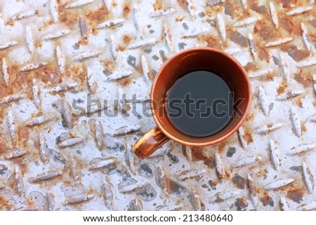 cup of coffee on a metal plate - stock photo