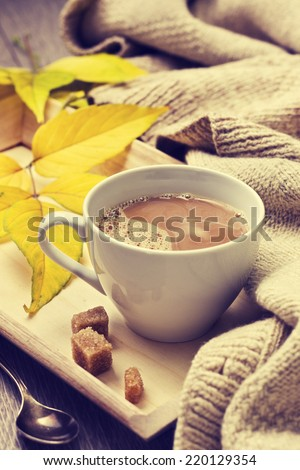 cup of coffee on a tray, warm woolen thing, autumn leaves (Vintage style) - stock photo