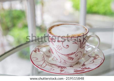 Cup of coffee on a window sill - stock photo