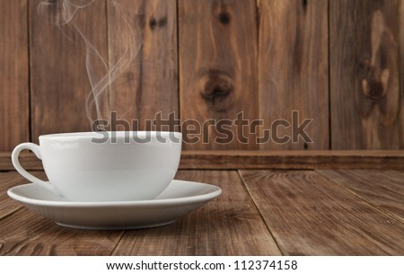 cup of coffee on a wooden background - stock photo