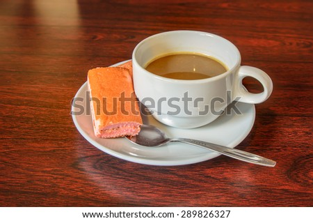 Cup of coffee on a wooden background.
