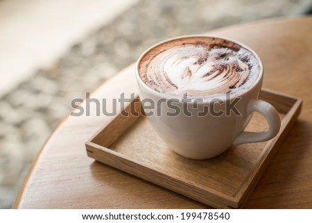 Cup of coffee on a wooden table , sunlight color - stock photo
