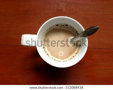Cup of coffee on a wooden table top view by iphone.  - stock photo