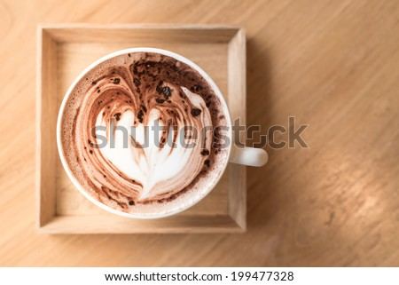 Cup of coffee on a wooden table ,unusual - stock photo