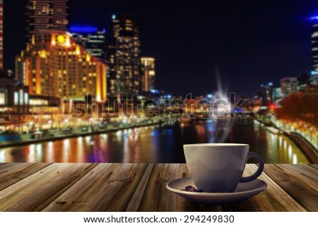 cup of coffee on abstract city background - stock photo