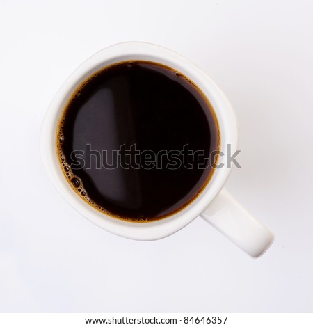 Cup of coffee on aromatic coffee beans. top view top view