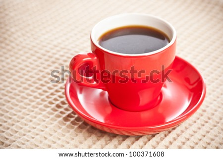 Cup of coffee on beige tablecloth