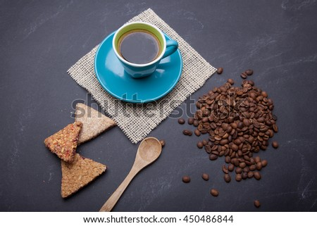 cup of coffee on black background - stock photo