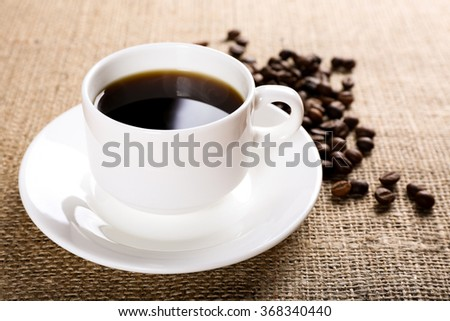 Cup of coffee on burlap background - stock photo