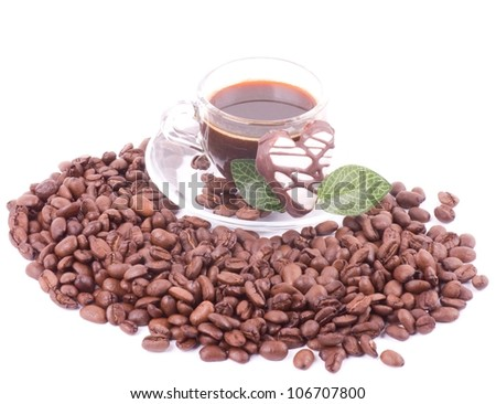 Cup of coffee on coffee beans on white background - stock photo