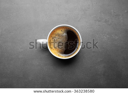 Cup of coffee on grey background, top view - stock photo