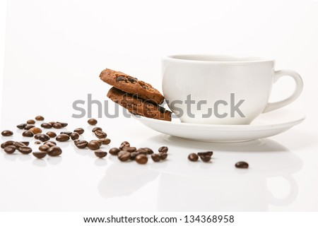 cup of coffee on saucer with biscuits isolated white background - stock photo