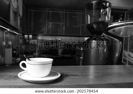 cup of coffee on table at coffee shop. - stock photo