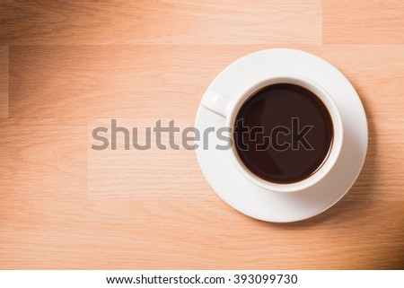Cup of coffee on table background