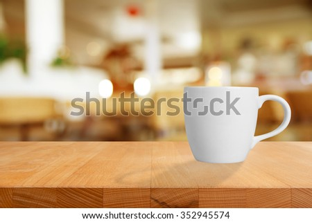 Cup of coffee on table in cafe. - stock photo
