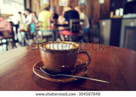Cup of coffee on table in cafe, vintage or retro color effect- shallow depth of field - stock photo