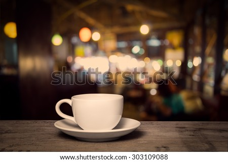 cup of coffee on table in cafe, vintage style - stock photo